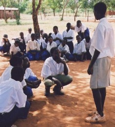 Tanzanian students learn about latrine use.