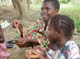 Ghanaian children learn from games.