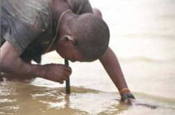 The Guinea worm pipe filter - a hard plastic straw covered at one end by filter material - is used to strain out the microscopic water fleas from the water, allowing people to prevent themselves from contracting Guinea worm disease while they move from place to place.