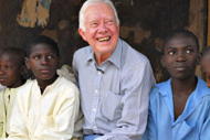 Former President Jimmy Carter visited Dauda Usman (left) and other children suffering from schistosomiasis during his Feb. 15, 2007, visit to Nasarawa North, Nigeria.