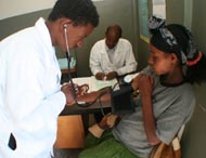 A health worker assesses a patient at Dukiem Health Center southeast of Addis Ababa