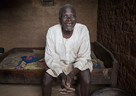 Photo of a smiling Nigerian man with river blindness.