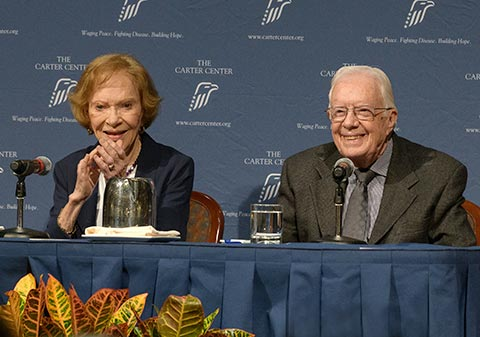 Photo of President and Mrs. Carter speaking at a Conversations event.