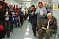 Voters wait for polls to open at a polling station in Falls Church, Va.