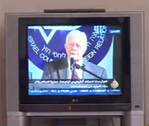 Photo of President Carter speaking at the press conference.