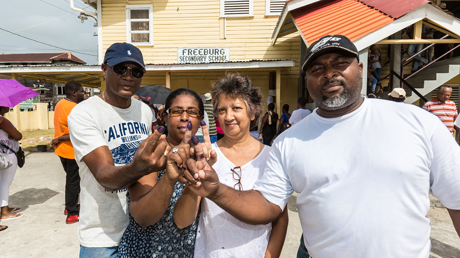 New voter Kirk Embrack takes his family to vote in Guyana