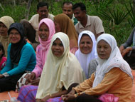 Women in Idi Tunong village, East Aceh, attend a meeting organized by the Aceh Party.