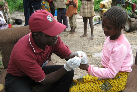 Solomon Izang tests Dorcas Azi for malaria.