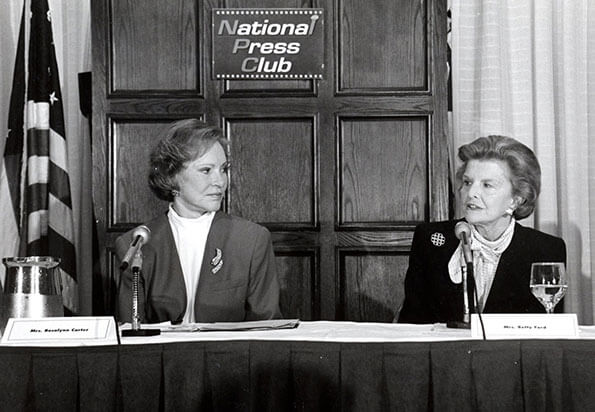 Former First Ladies Rosalynn Carter and Betty Ford joined bipartisan forces to testify in the U.S. Senate and speak at the National Press Club on March 7, 1994, calling for comprehensive mental health and substance use insurance benefits.