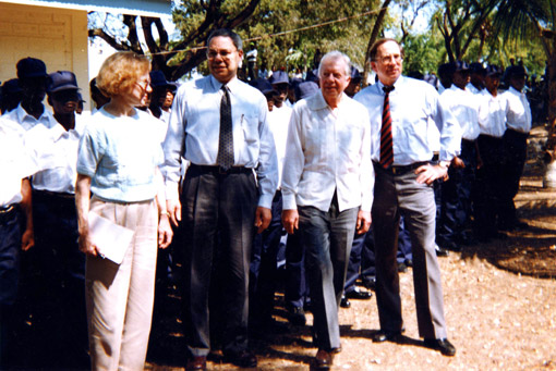 Former First Lady Rosalynn Carter joined former Chairman of the Joint Chiefs of Staff Colin Powell, former U.S. President Jimmy Carter, and then-U.S. Senator Sam Nunn (D-Ga.) on a trip to Haiti.