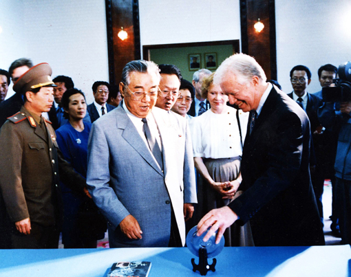President and Mrs. Carter admire a gift presented by North Korea President Kim Il Sung.