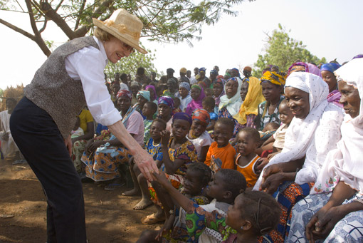 Former First Lady Rosalynn Carter greets children during a Carter Center visit to Tingoli, Ghana.