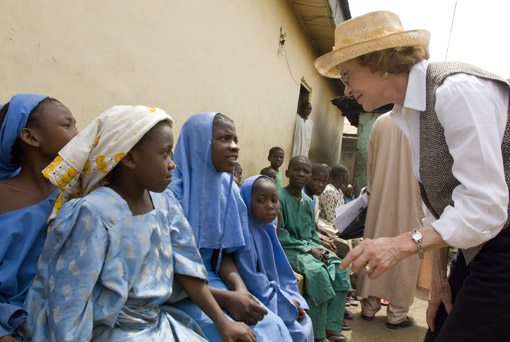 Former First Lady Rosalynn Carter greets schoolgirls suffering from schistosomiasis.