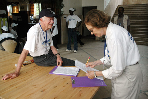 Former First Lady Rosalynn Carter organizes observation papers in preparation for poll closing procedures.