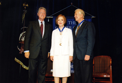 President and Mrs. Carter receive the Presidential Medal of Freedom from President Clinton at a ceremony at The Carter Center in Atlanta.