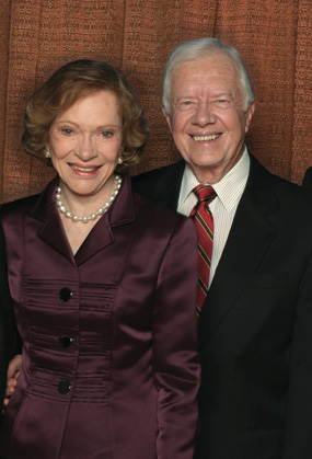 Former U.S. President Jimmy Carter and his wife, Rosalynn, pose at the Atlanta Symphony Hall in the Woodruff Arts Center in Atlanta, Georgia, at an event celebrating President Carter's Nobel Peace Prize.