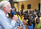 Former U.S. President Jimmy Carter addresses Ghanaian children outside Savelugu Hospital, asking