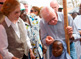 Former U.S. President Jimmy Carter and Carter Center CEO and President John Hardman measure a little girl's height to gauge the accurate medication needed to prevent schistosomiasis.