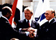 Egyptian President Anwar Sadat (left), U.S. President Jimmy Carter, and Israeli Prime Minister Menachem Begin make a three-way handshake at the signing of the Egyptian-Israeli Peace Treaty.