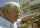 Former U.S. President Jimmy Carter shakes the hands of eager schoolchildren during his historic trip to Cuba.