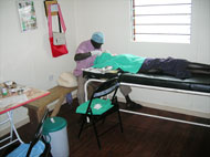 A locally trained surgeon operates in the new clinic.