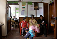 A family waits outside Rita Jimenez Huancollo's office at the Integrated Justice Center in La Paz, Bolivia.