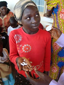 14-year-old Nigerian girl holds medication