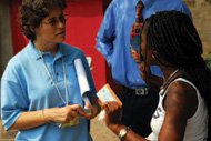 Karin Ryan (left) listens to a voter explain the trouble she's had with her registration card during the 2006 elections in the Democratic Republic of the Congo.