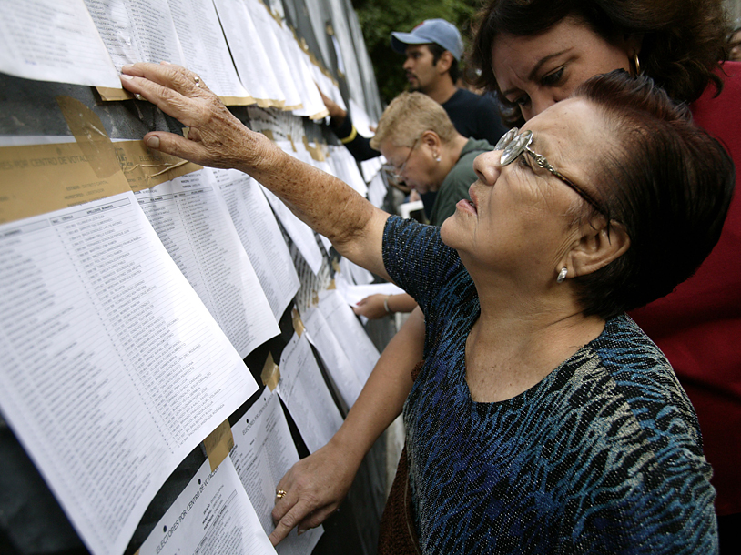 Woman reading voting list