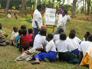 Ugandan community members gather for health education about river blindness.
